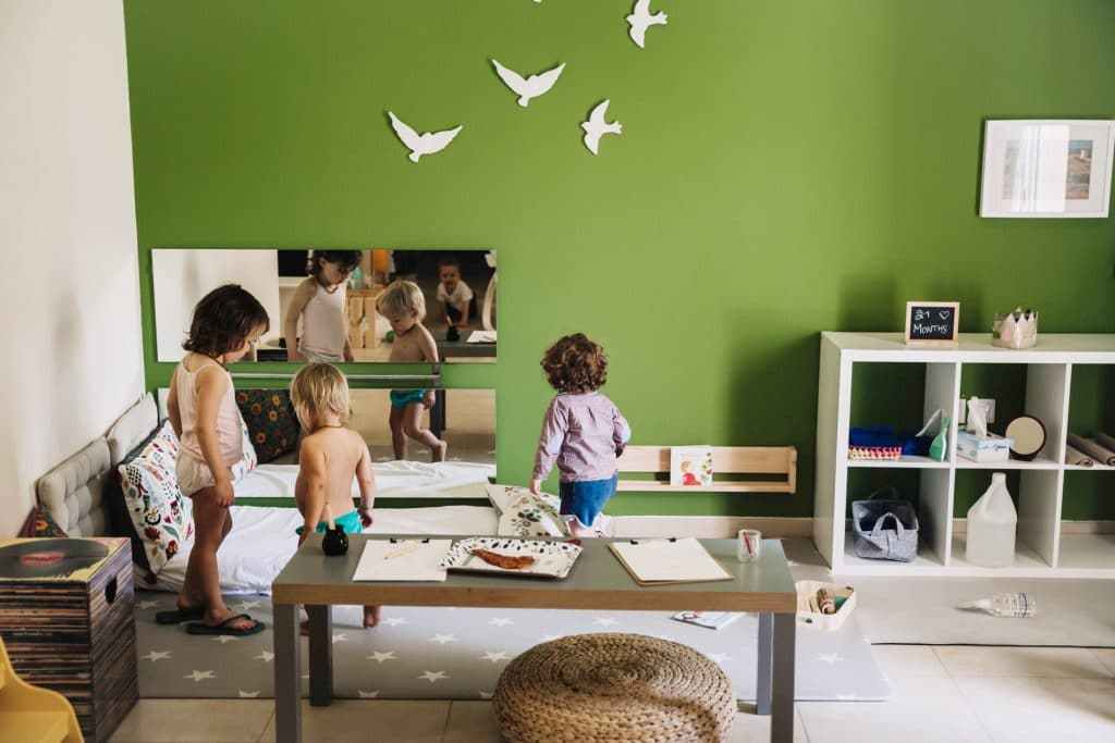 Young children in Montessori playroom