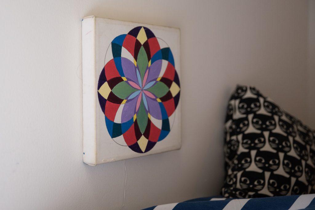 handmade mandala on wall in child's bedroom
