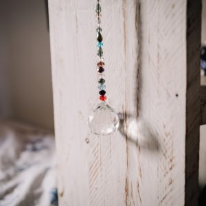 Crystal hanging from shelf in child's bedroom