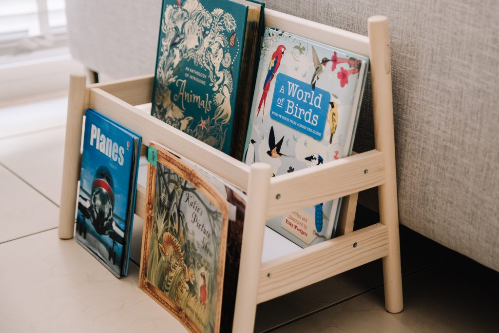Child's low bookshelf showing four books with covers facing forward