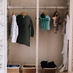 Child's wardrobe with limited choice of clothing hanging up