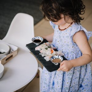 Preschooler carrying tray of food