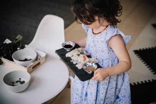 Preschooler carrying tray of food